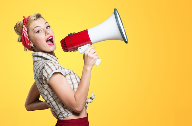 Portrait of woman holding megaphone, dressed in pin-up style