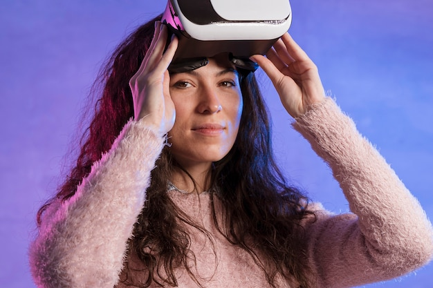 Portrait of woman holding a vr set with hands
