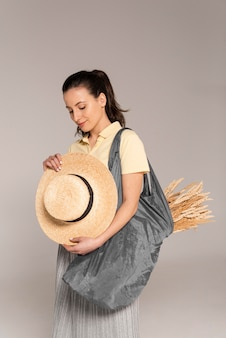 Portrait woman holding wheat in plastic bag