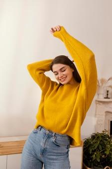 Portrait woman at home dancing