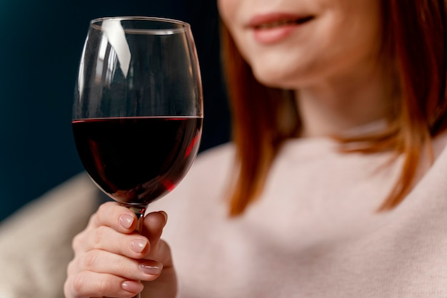 Portrait woman at home relaxing with glass of wine