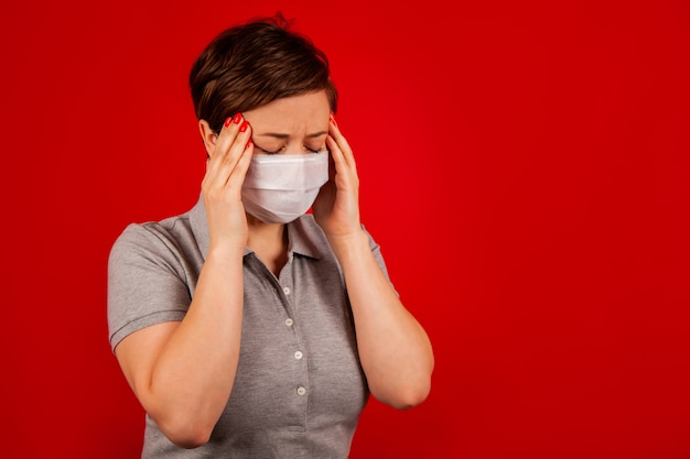 Portrait of a woman in a mask with a symptom of a virus disease.