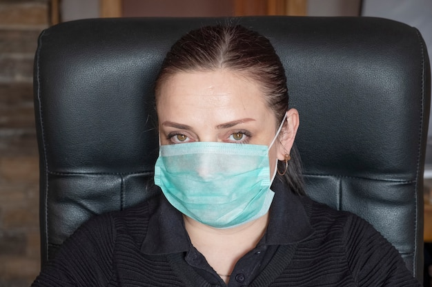 Portrait of a woman in medical face mask at work