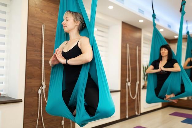 Portrait of woman meditation in hammock.