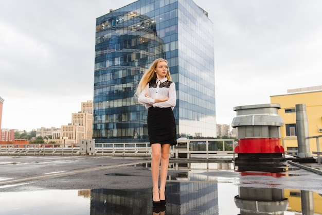 Portrait of woman in office looks at the roof