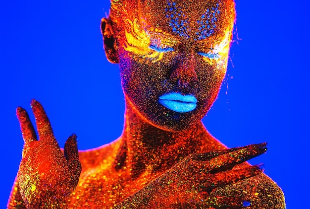 Portrait of a woman painted in fluorescent powder.