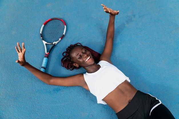 Portrait woman playing tennis