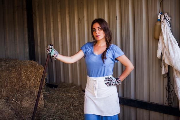Portrait of woman posing in barn