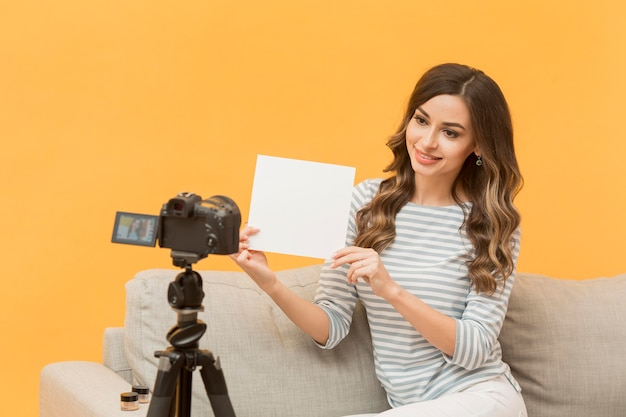 Portrait of woman recording video