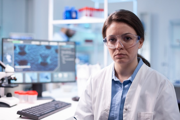 Portrait of woman scientist in chemistry laboratory looking