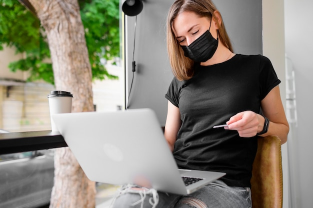 Portrait of woman shopping online