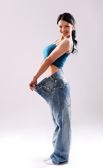 Portrait of a woman showing her weight loss
