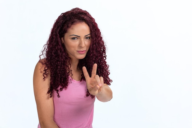 Portrait of a woman signaling ok with her hand and fingers. isolated on a white background.
