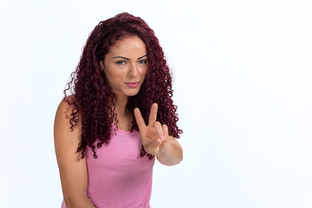 Portrait of a woman signaling ok with her hand and fingers