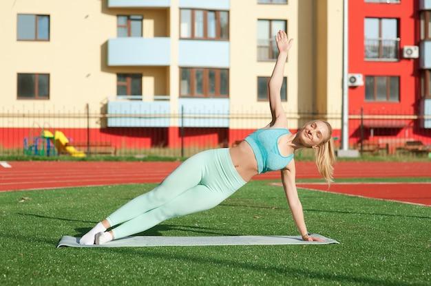 Portrait woman at stadium doing yoga