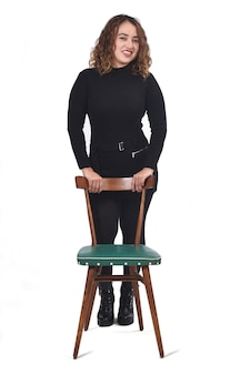 Portrait of a woman standing with chair