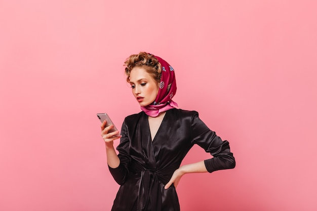 Portrait of woman in stylish home outfit chatting in phone