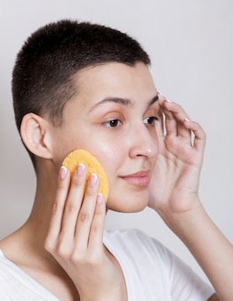 Portrait of woman taking care of her face