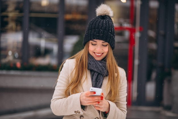 Portrait of woman talking on phone in the street