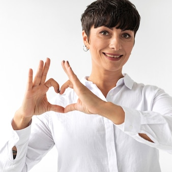 Portrait of woman teaching sign language