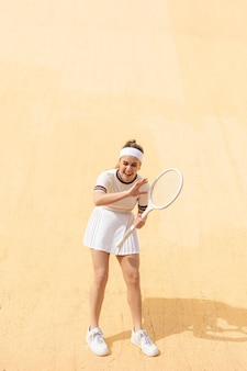 Portrait woman tennis player laughing