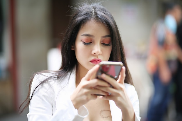 Portrait of woman texting on mobile phone