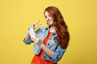 Portrait woman using mobile phone for interaction video calling by showing two fingers