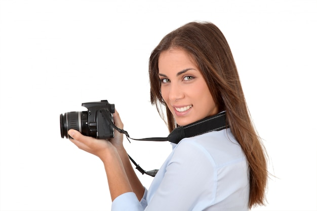 Portrait of woman using reflex digital camera