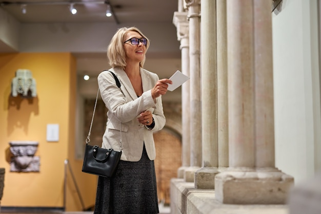 Portrait of a woman visiting historical museum