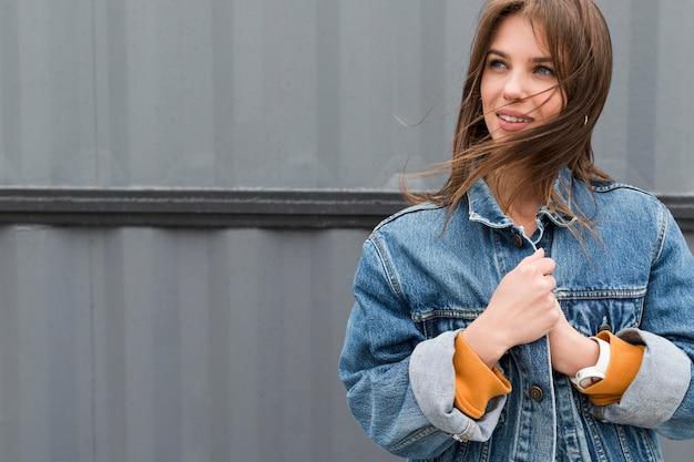 Portrait woman wearing denim jacket