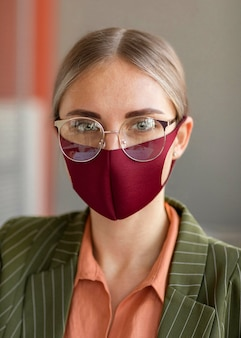 Portrait of woman wearing face mask at work