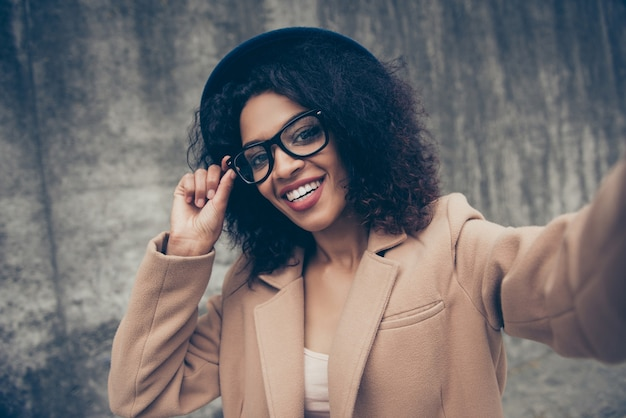Portrait woman wearing glasses and hat