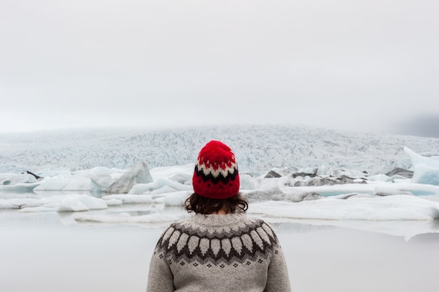 Portrait of a woman wearing an icelandic sweater in front of fjallsarlon lagoon