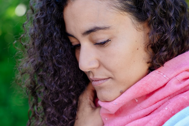 Portrait of woman wearing pink scarf