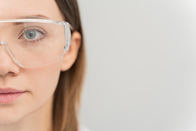 Portrait of woman wearing protective goggles with copy space