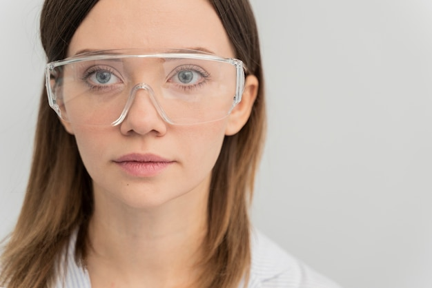Portrait of woman wearing protective goggles