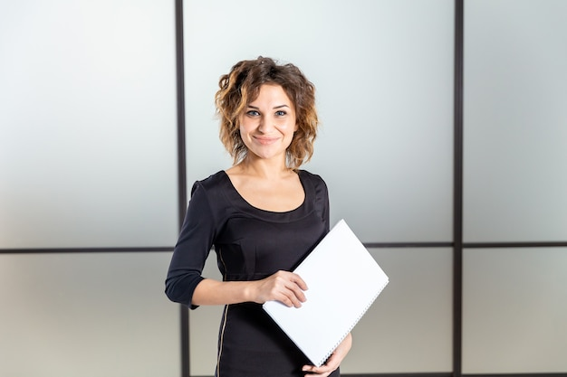 Portrait of woman in white office with documents isolated.