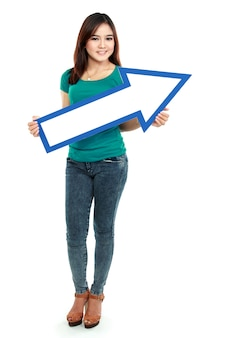 Portrait of woman with arrow sign