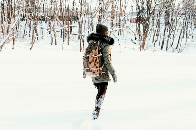 Portrait woman with backpack on winter day