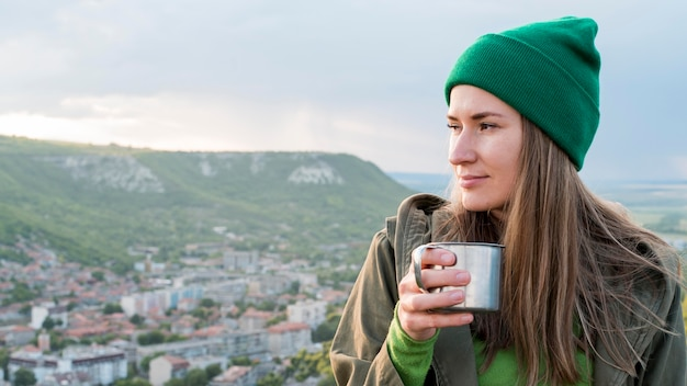 Portrait of woman with beanie enjoying view