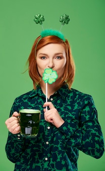 Portrait of woman with beer celebrating saint patrick's day