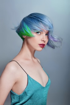 Portrait of a woman with bright colored flying hair