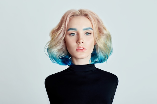 Portrait woman with bright colored flying hair