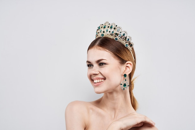 Portrait of a woman with a crown on her head makeup model close-up lifestyle. high quality photo