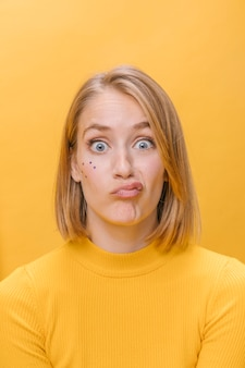 Portrait of woman with different facial expressions in a yellow scene