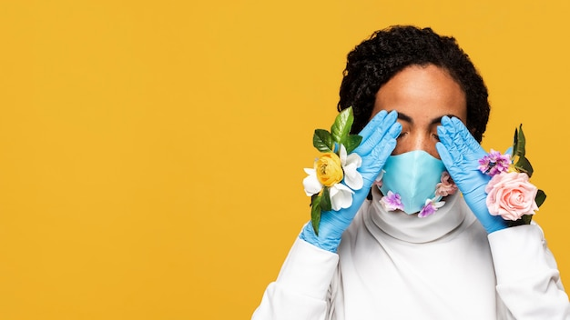 Portrait of woman with floral gloves and floral mask