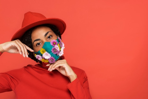 Portrait of woman with floral mask