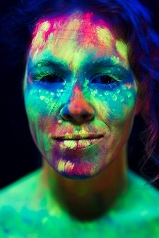 Portrait of woman with fluorescent make-up