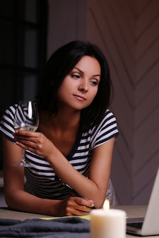 Portrait of woman with glass of wine