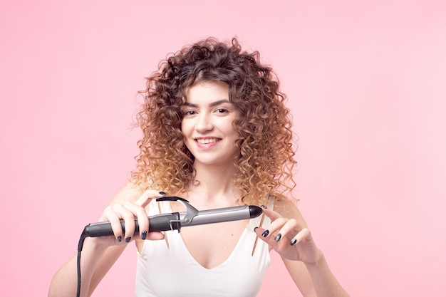 Portrait woman with hair curler